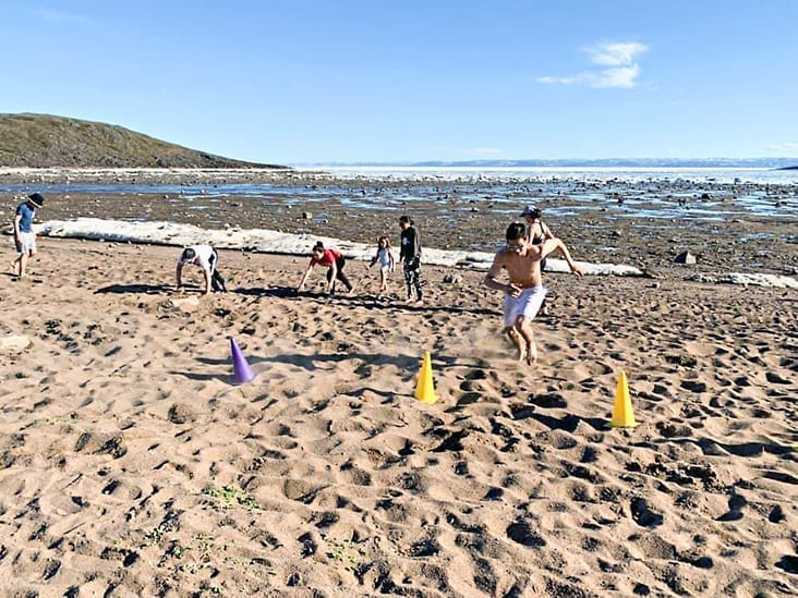 Aiden Anawak of Iqaluit heads for the pylons during a drill as part of the Volleyball Nunavut beach volleyball training camp in Apex, just outside of Iqaluit, late last month. photo courtesy of Volleyball Nunavut