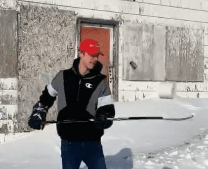 Austin Caza of Iqaluit shows off his stickhandling skills with a roll of toilet paper outside the old Hudson's Bay store in Iqaluit earlier this month. The video was put together by Laisa Kilabuk and has generated plenty of positive feedback. image courtesy of Laisa Kilabuk